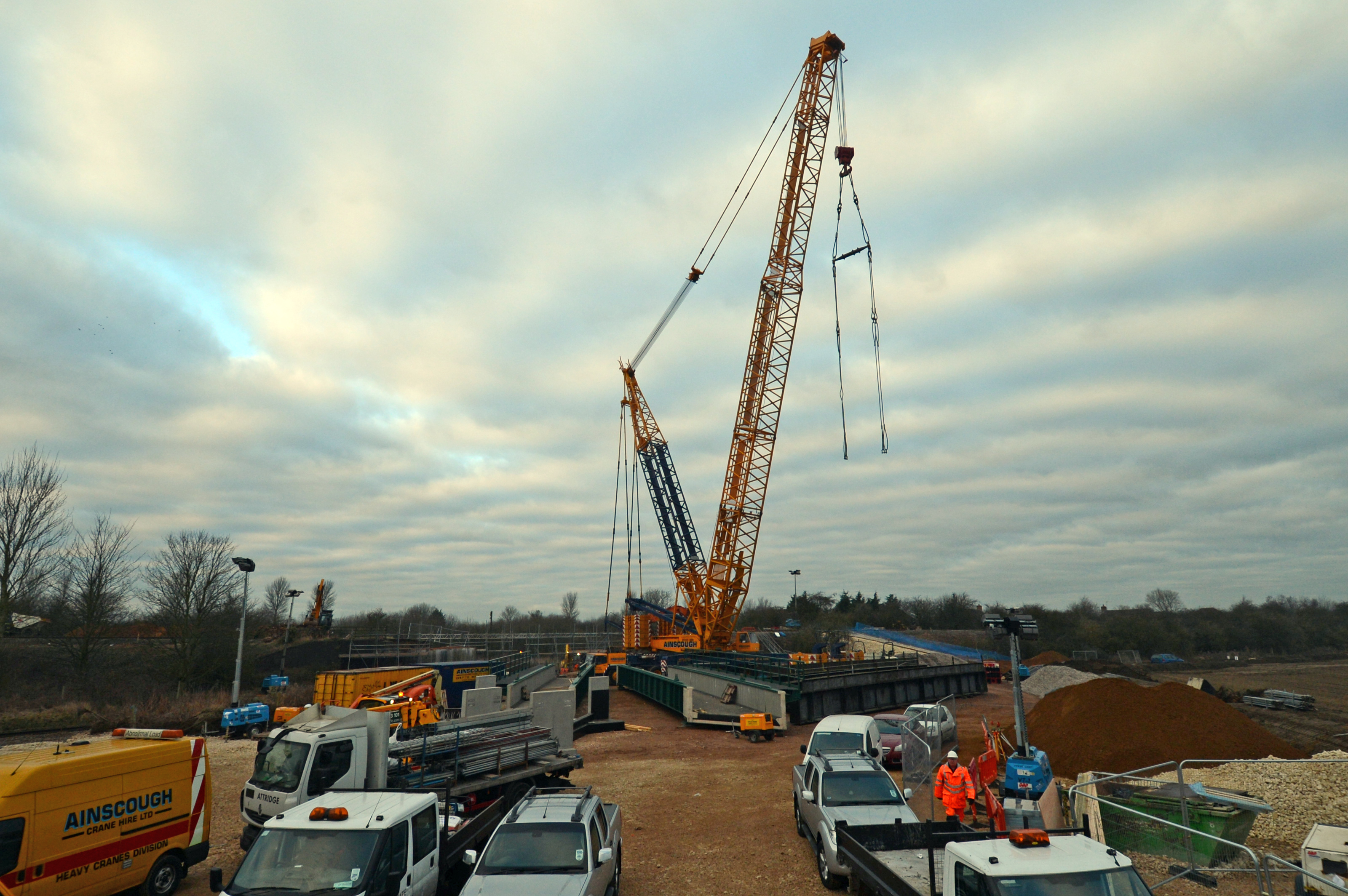 In March 2013 three different bridges on the Sleaford avoiding line were replaced during a 10 day blockade.  Here, a 1000 tonne crane rests after lifting out the old rail bridge over the railway line to Skegness.  In the foreground to the left of the old bridge you can see the two sections of the new bridge ready to go in.