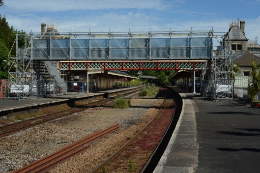 The temporary footbridge with the main station buildings beyond.