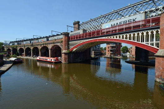 The changing face of freight traffic in Manchester. An intermodal train bound for Trafford Park passes the canals that kickstarted the industrial revolution