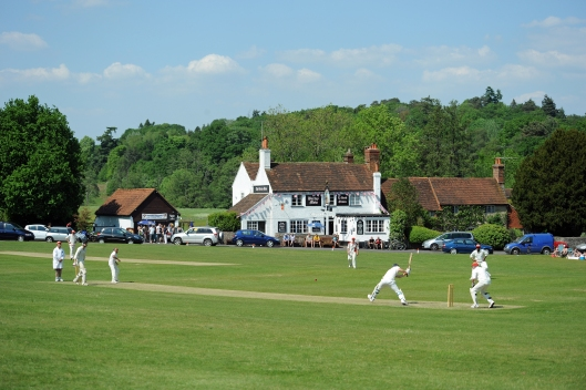 Quintessentially English, cricket on the village green outside the local pub