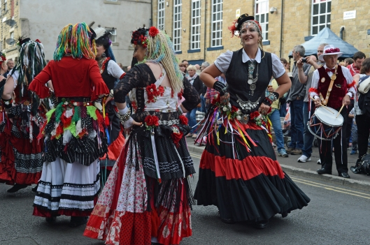 400 Roses are regulars at Rushbearing. They combine UK-style folk dancing with more exotic tribal belly dance moves. When designing their costumes they decided to use an abundance of red and white silk roses appropriate to their Yorkshire & Lancashire origins, hence their name.