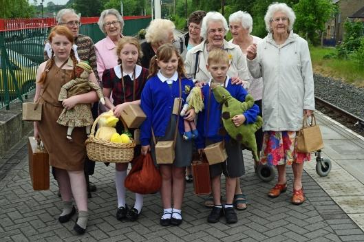 DG271453. Some of the original Lowestoft evacuees with local children. Glossop. 2.6.17.JPG