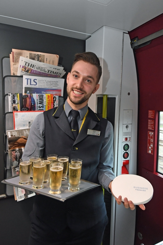 DG289823. Champagne is served. train 9114, the press trip to Amsterdam. 20.2.18