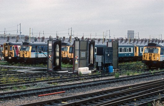 04961. 309618. 305513. 305509. 55009. Stored in the carriage sidings. Blackpool North.19.6.95crop