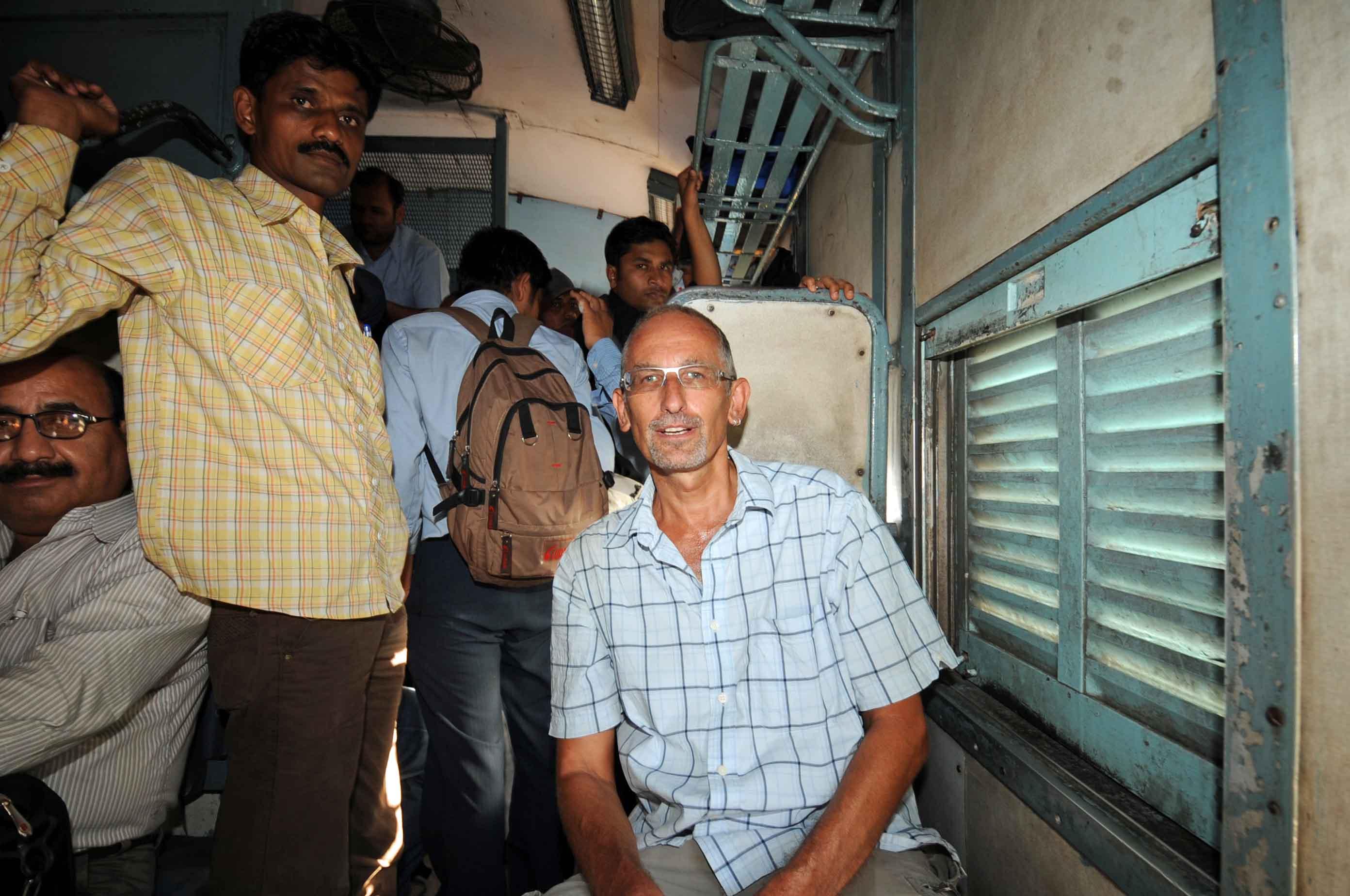 DG77491. Me on crowded train. Gujarat. India. 26.3.11crop