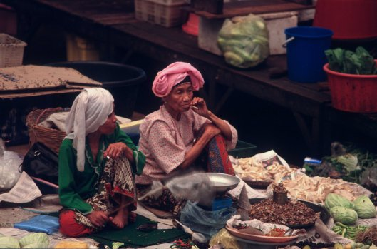 T7306. Two old women on a stall. Indoor market. Kota Baru. Malaysia. June. 1998crop