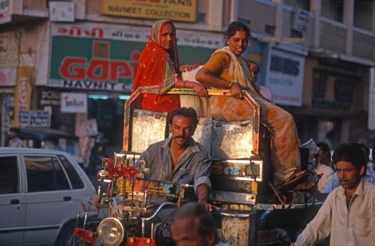 T9638. Women sit atop sacks on a motor rickshaw. Rajkot. Gujarat. India. 11.02.2000crop