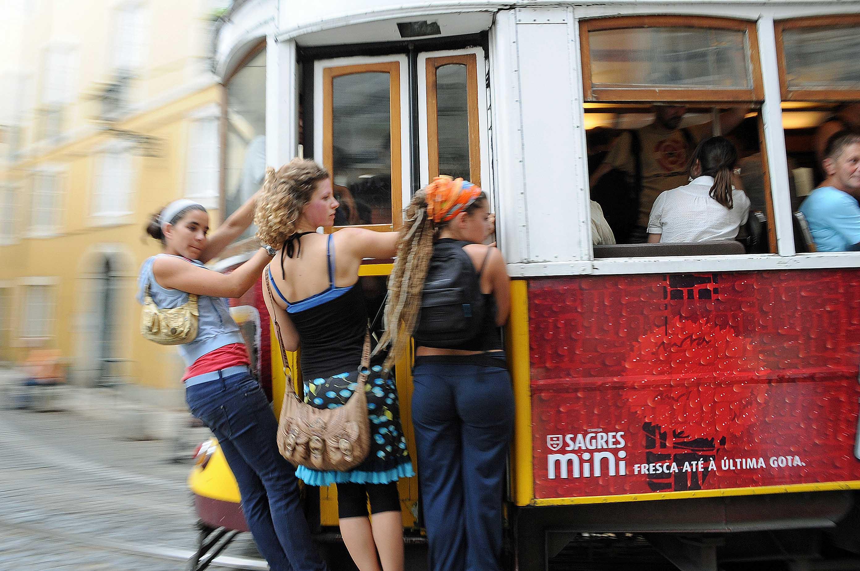 DG53199. Tram surfing. Lisbon 2.6.10.crop
