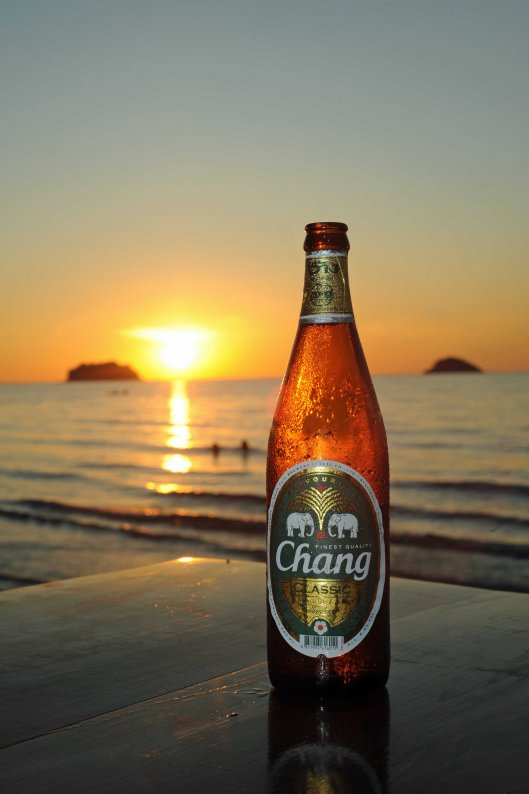 DG99372. A sunset beer Chang on Ko Chang. Thailand. 28.11.11. crop